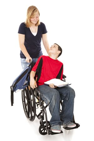 wheelchair man: Teen girl pushing her disabled friend in his wheelchair.  Full body isolated. Stock Photo