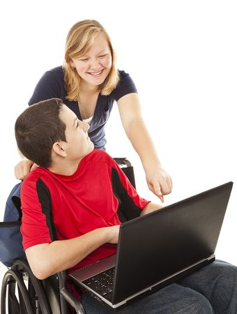 disable: Disabled teen boy and a friend having fun on the computer.  Isolated on white. Stock Photo
