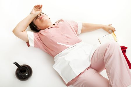 Waitress collapsed on the floor with exhaustion. Stock Photo - 6337172
