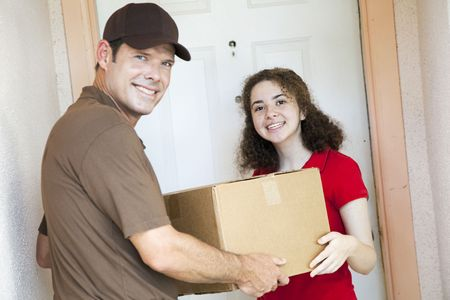 delivery driver: Happy customer receiving a package from a delivery man.  Focus on girl.