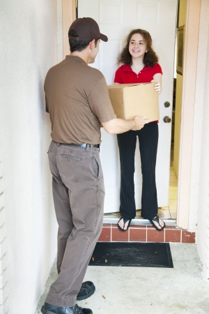 post man: Girl receiving a package from a delivery man.