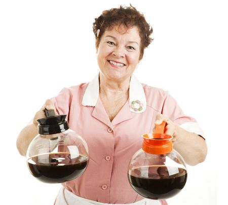 Friendly smiling waitress offers a choice between regular or decaffeinated coffee.  Isolated on white.