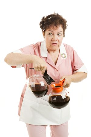 Sneaky waitress substitutes caffeinated coffee for the decaf.  Isolated on white. Stock Photo - 6337115