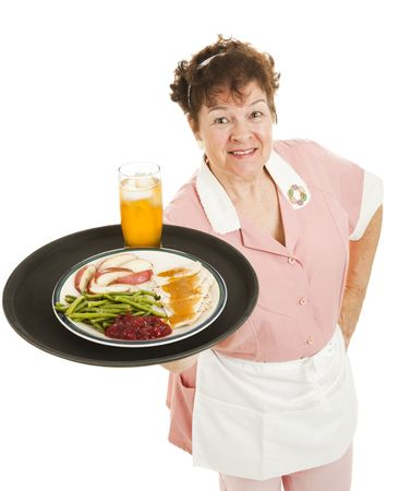 Friendly waitress serving a turkey dinner on her tray.  Isolated on white.