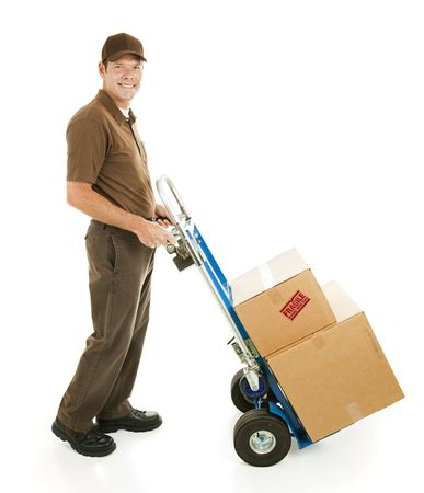 hand move: Profile view of a handsome delivery man or mover carrying boxes on a hand cart.