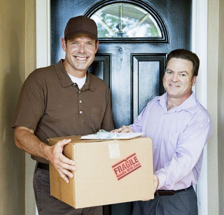 courier: Delivery man hands package to satisfied customer.