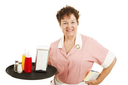 Waitress puts away condiments at the end of the day.  Isolated Stock Photo - 6453376