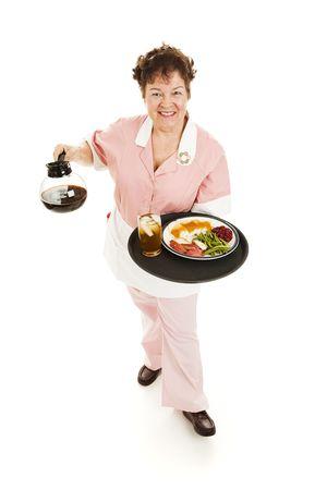 Friendly waitress serving you. photo