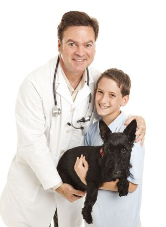 Veterinarian with a little boy and his Scotty dog.  Isolated on white. photo