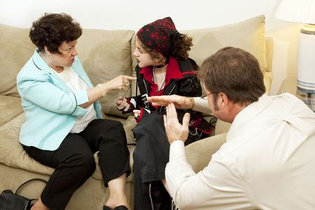 rebellious: Mother and her rebellious teen daughter fighting while the counselor calls for a time out.   Stock Photo