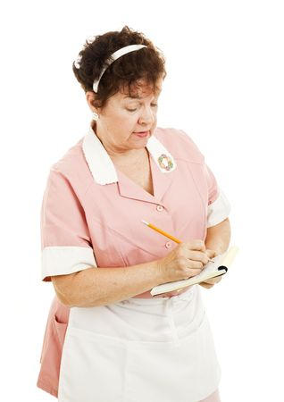 Waitress writing down an order on her pad.  Isolated on white. Stock Photo - 6543345