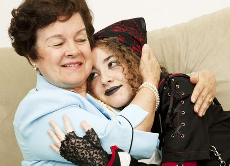 Mother and rebellious goth daughter hugging each other.   photo