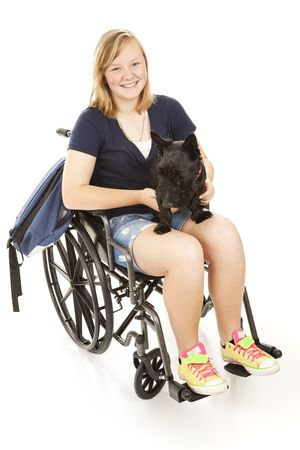 disable: Disabed teen girl with her backpack and her Scotty dog.  Full body isolated on white.