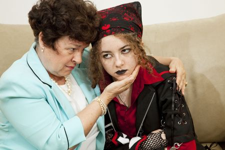 Worried mother trying to talk with her angry teenage daughter.   photo