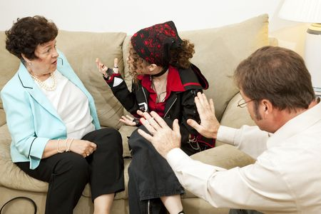 rebellious: Teen girl yelling at her mother during a family counseling session.