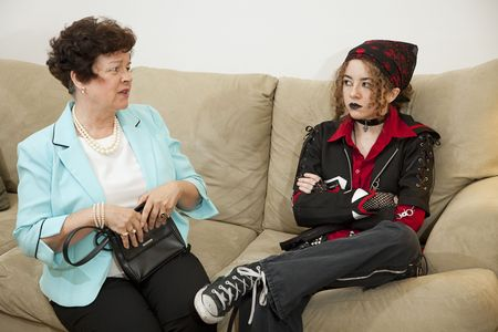 rebellious: Rebellious teen and worried mother have trouble communicating with each other.   Stock Photo