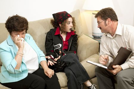 Teen girl complains to the therapist as her mother cries.  (designs on bandana and jacket are generic and not part of a trademark or copyright) photo
