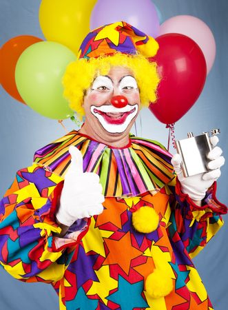 Drunken clown drinking from a flask and giving the thumbsup sign. Imagens