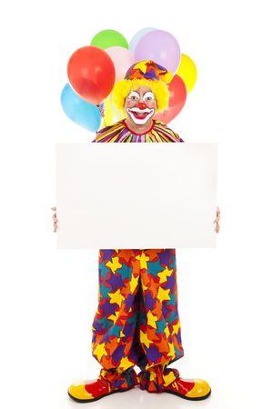 birthday clown: Happy clown holding a blank sign.  Full body on white.