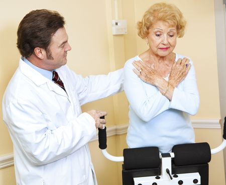 Senior woman doing physical therapy on her back with the help of a chiropractor. photo