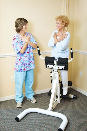 Physical therapist working with a chiropractic patient to improve her spine flexibility.   photo