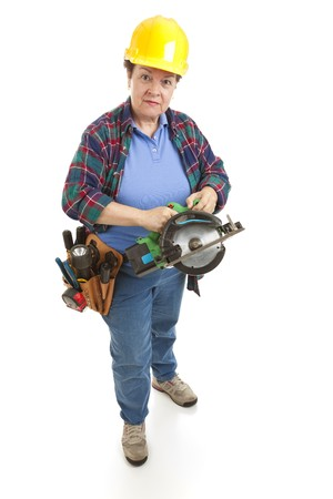 Female construction worker holding a circular power saw.  Full body isolated on white. photo