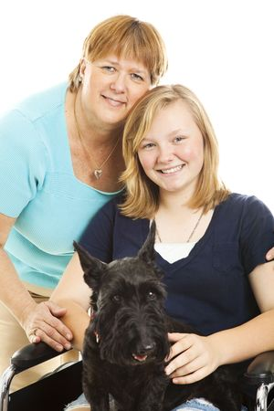 Mother, disabled teen daughter and their Scotty dog pose for a portrait. White background. photo