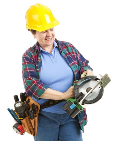 Female construction worker with a circular power saw.  Isolated on white. photo