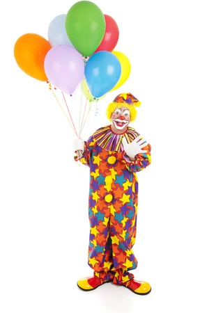 Happy birthday clown holding a bunch of balloons.  Full body isolated  photo