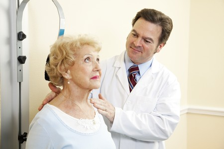 Chiropractic doctor treating an elderly patient for whiplash. photo