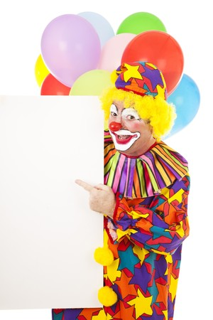 Happy circus clown pointing to a blank sign, ready for your text. Isolated on white.