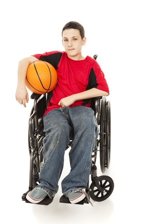 Teenage athlete in a wheelchair, holding his basketball.  Full body isolated on white.   photo