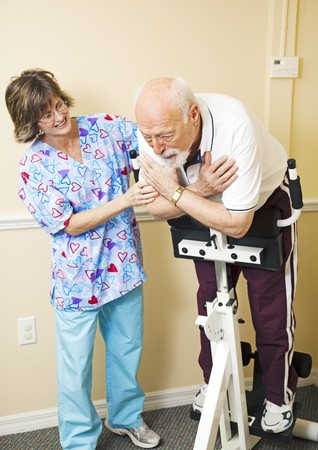 Senior man struggles to do physical therapy for his back problems. Stock Photo - 7034037