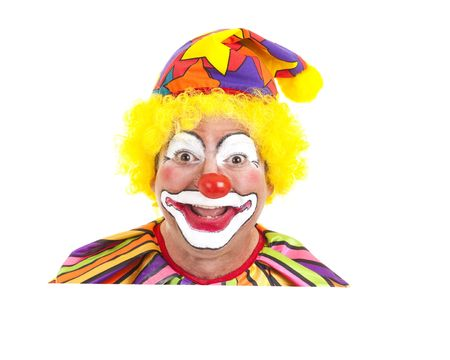 Clown face peeking over blank white space.  Isolated design element. photo