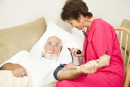 old man on a physical pressure: Home health care nurse taking a senior patients blood pressure.