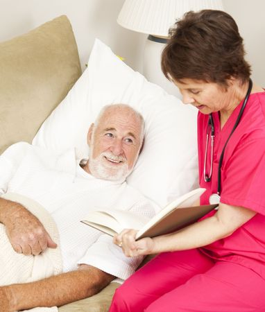 Patient enjoys listening to a story as a home health nurse reads to him.   Stock Photo - 7170564