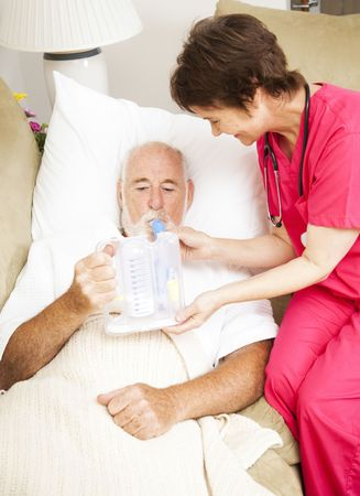 Home health nurse uses spirometer to strengthen patients lungs and prevent pneumonia.  photo