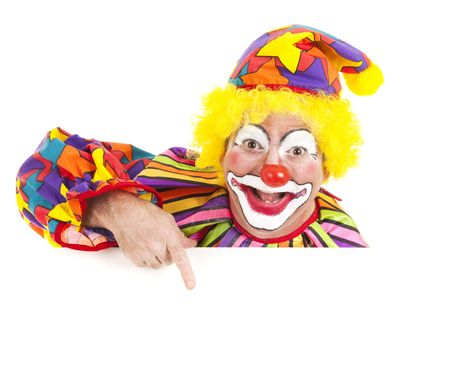 clown: Cheerful clown pointing to blank white space.  Isolated design element. Stock Photo
