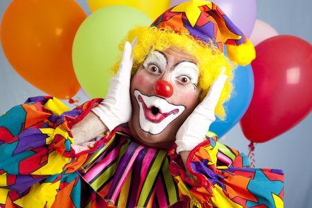 Birthday clown in full costume, looking surprised.