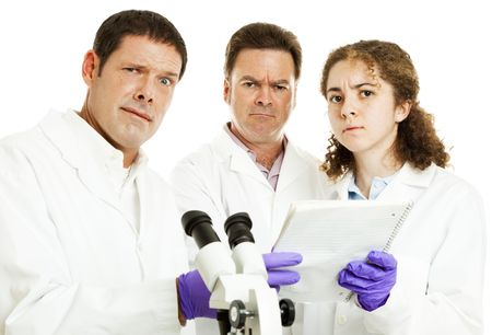 confused woman: Perplexed, confused scientists looking at lab results.  White background.