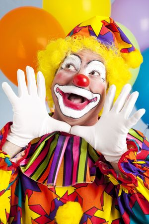 clown's nose: Adorable birthday clown making a jazz hands gesture.