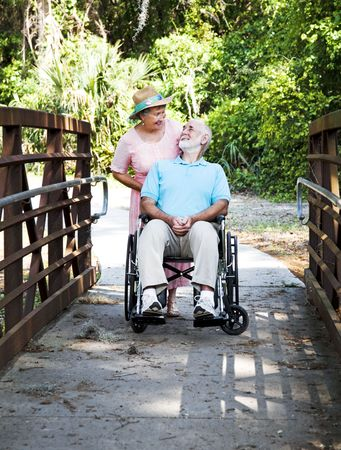 devoted: Devoted senior wife cares for her disabled husband.