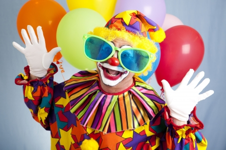oversized: Funny birthday clown in hilarious oversized sunglasses.  Stock Photo
