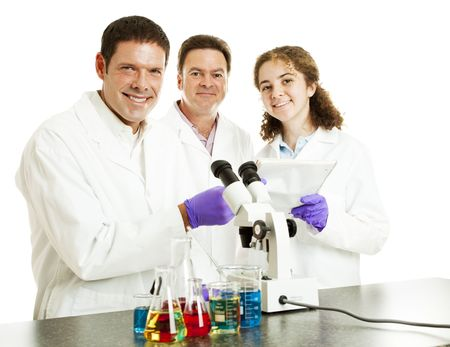 Three happy scientists in their laboratory.  Isolated on white. Stock Photo - 7281976