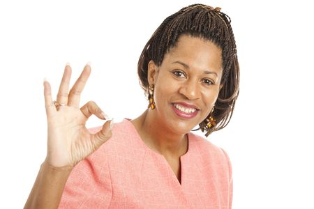 cornrows: Beautiful African-American businesswoman giving the okay sign.