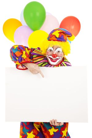 Funny circus clown holding a blank white card, ready for your message.  Isolated. Stock Photo