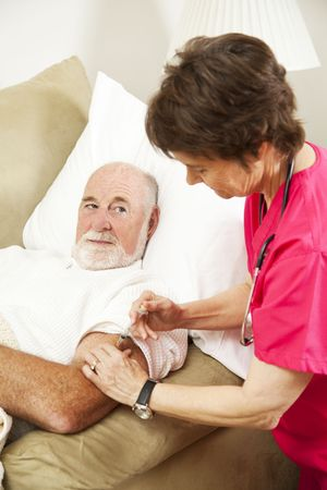 Homebound senior man gets an injection from his nurse.   photo