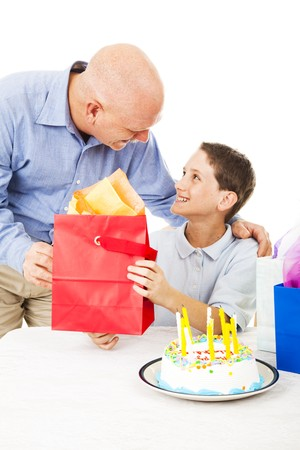 Cute little boy gets a birthday gift from his father.  White background. photo