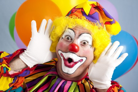 circus clown: Colorful birthday clown making a funny face.