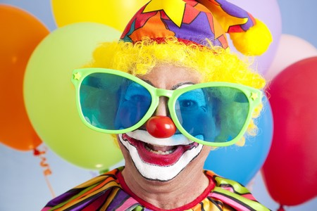 oversized: Portrait of silly clown in oversized sunglasses.